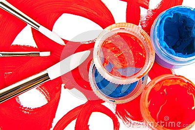 Three brushes and tubes with paint