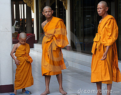 Three buddhist monks of various ages are waiting Editorial Stock Photo