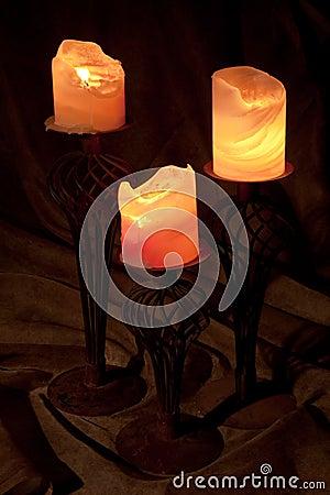 Three burning candles