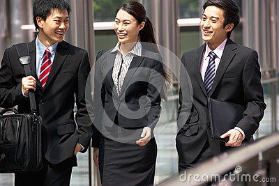 Three Business Colleagues Having Discussion