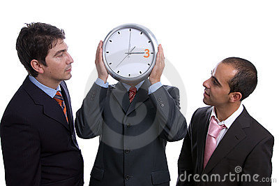 Three business men with clock