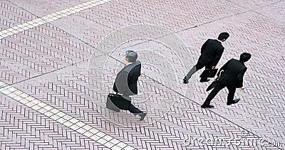 Three business men walking