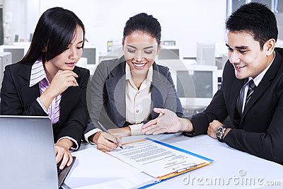 Three Business Partners In Meeting