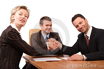 three business people handhshake