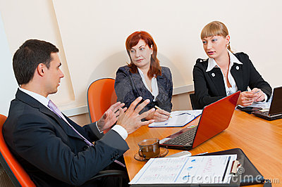 Three business people are meeting