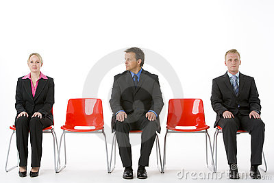 Three Business People Sitting On Red Plastic Seats Royalty Free Stock Image - Image: 6879486