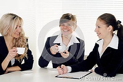 Three business women sitting