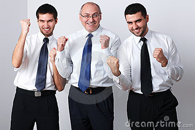 Three businessman celebrate success