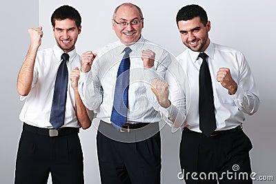 Three businessman celebrate success
