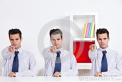 Three businessman pointing