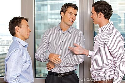 Three businessmen discussing
