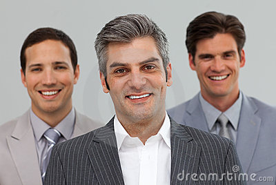 Three businessmen smiling at the camera