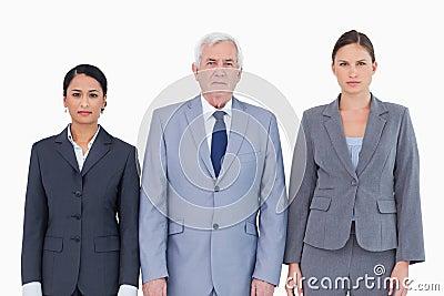 Three businesspeople standing