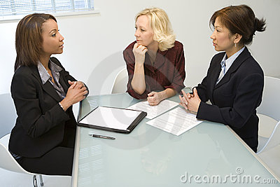 Three businesswomen at desk