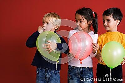 Three children with balloons