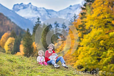 Three children in beautiful snow covered mountains
