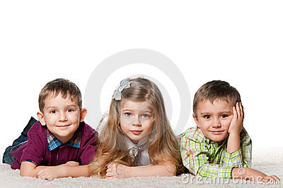 Three children on the carpet
