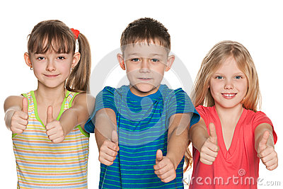 Three children hold their thumbs up