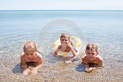 Three children in the sea