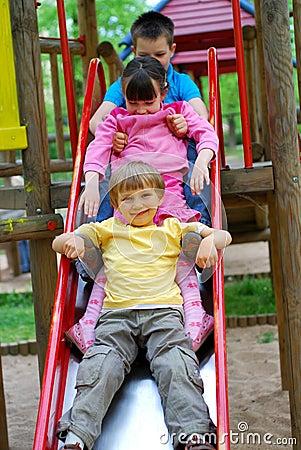 Three Children on Slide
