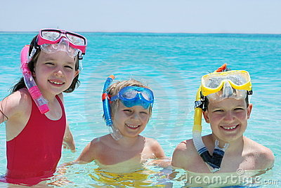 Three children with snorkels