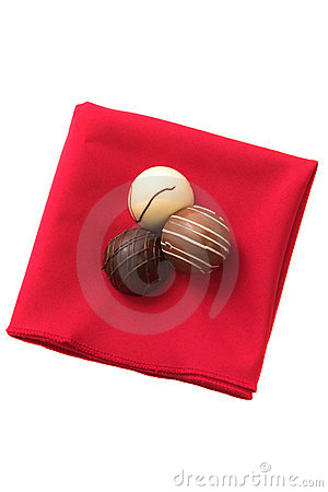 Three Chocolates on a red serviette