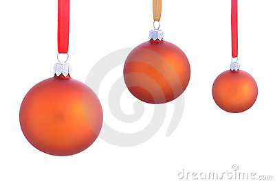 Three christmas baubles isolated on white