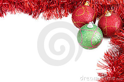 Three Christmas baubles with red tinsel