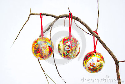 Three Christmas Decorations On A Dry Branch