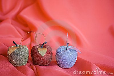 Three christmas tree apples on red