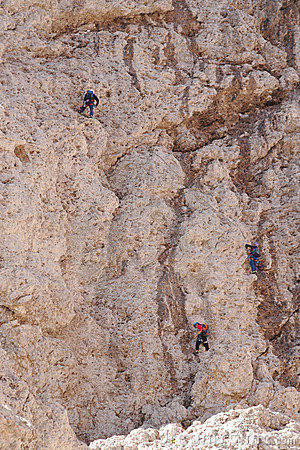 Three climbers on cliff