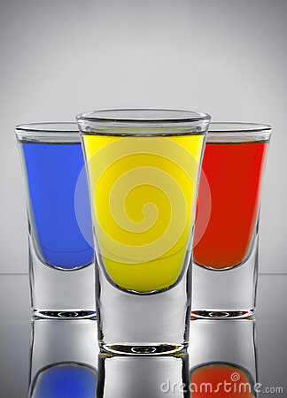 Free Three Cocktails Yellow Red And Blue Colors In Three Wine-gla Royalty Free Stock Photography - 76880347