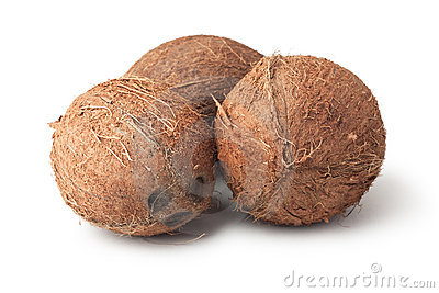 Three coconuts isolated on the white