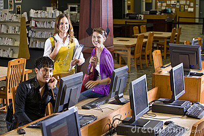 Three college students hanging out in library