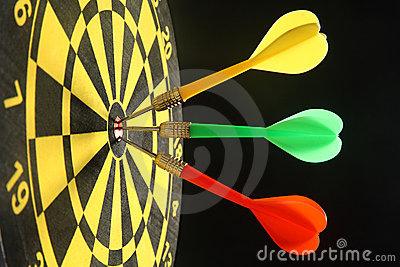 Three colorful darts.