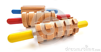 Three colorful rolling pins