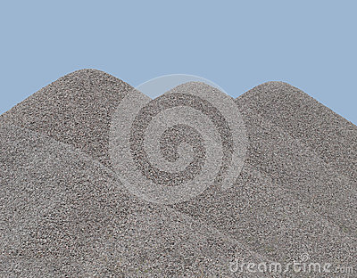 Three cone-shaped gravel piles isolated.