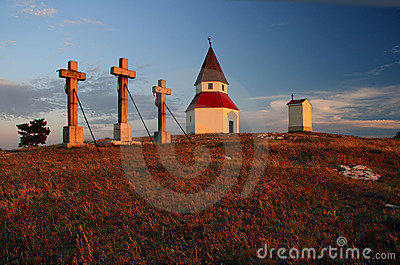 Three crosses and chapel on a hill