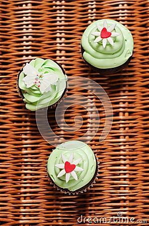 Three cupcakes on a basket