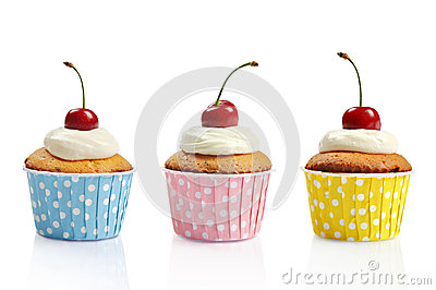Three cupcakes and cherries