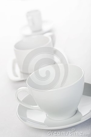 Three cups on tablecloth