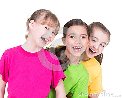 Three cute little cute smiling girls.