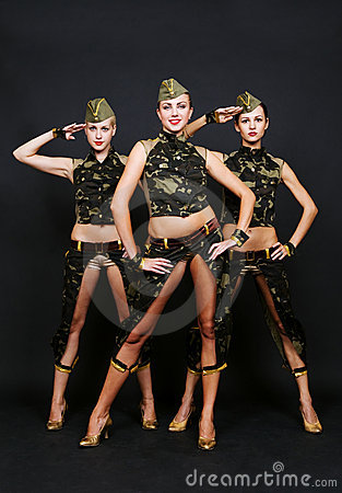 Three dancers in military uniform