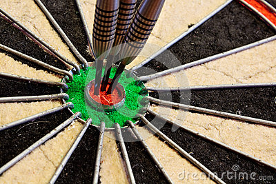 Three Darts in bullseye