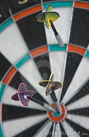 Three darts in dartboard
