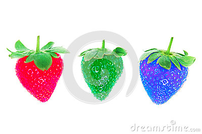 Three different colors of strawberries.