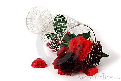 Three different red tint roses in mesh vase