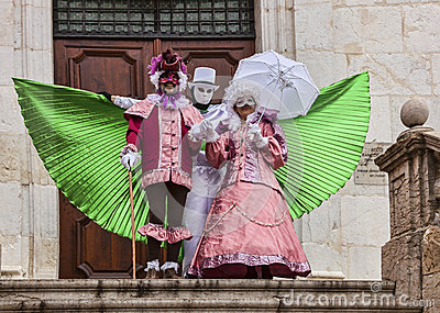 Three Disguised Persons Editorial Stock Photo