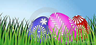 Three Easter eggs in grass