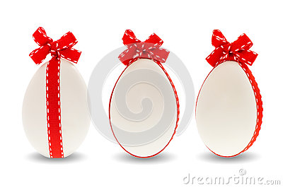 Three easter eggs with red ribbon bow